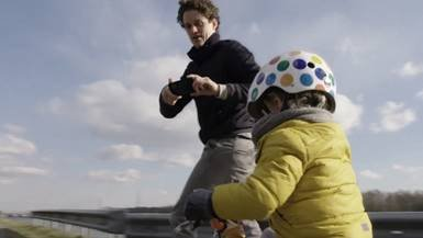 Father filming his little son cycling